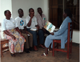 Jussy (on the right) with peers during a group discussion about positive living