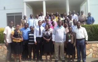 Insurance Group Agents, Health Partners and ICOBI staff pose for a photo with the Minister of State for Health (General Duties) during the training on Community Health Insurance